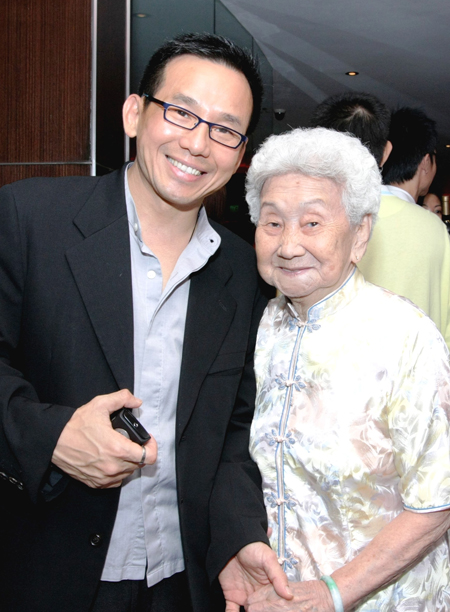 with mother at movie gala